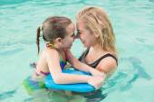 Happy mother and daughter in the swimming pool — Foto de Stock