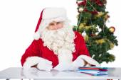 Portrait of father christmas writing list  — Foto Stock