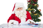 Portrait of father christmas writing list  — Стоковое фото