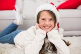 Festive little girl smiling at camera — Stok fotoğraf