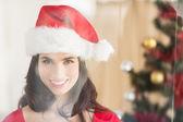 Festive brunette posing at christmas  — Stock fotografie
