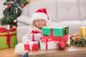 Cute little girl surrounded by christmas gifts — Stock Photo