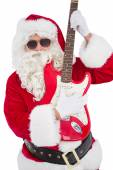 Santa with sunglasses playing electric guitar — Stockfoto