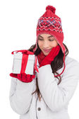 Content brunette in winter clothes holding gift — Stock Photo