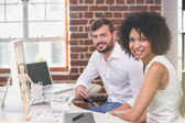 Smiling photo editors in office — Stock Photo