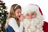 Little girl teling santa claus a secret — Photo