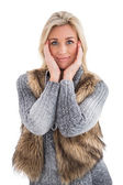 Blonde in winter clothes smiling at camera — Stock Photo
