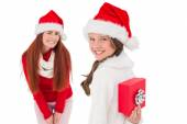 Mother and daughter with christmas gift — Stock Photo
