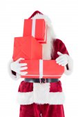 Santa covers face with presents — Stock Photo