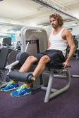 Man doing leg workout at gym — Stock Photo