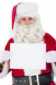 Cheerful santa claus holding page — Stockfoto
