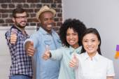 Creative team gesturing thumbs up — Stock Photo