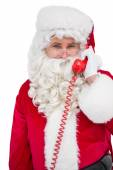Smiling santa claus on the phone — Stock Photo