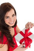 Smiling brunette opening gift  — Стоковое фото