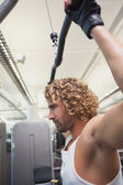 Man exercising on lat machine — Stock Photo