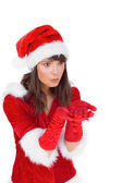 Pretty girl holding hands out in santa outfit — Stock Photo