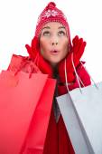 Blonde in winter clothes holding shopping bags — Stok fotoğraf