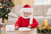 Festive little boy writing wish list — Stockfoto