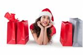 Festive brunette lying with shopping bags  — Foto Stock