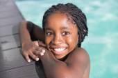 Cute little girl swimming in the pool — Foto de Stock