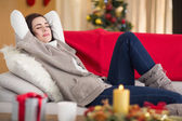 Brunette napping on the couch at christmas — Stock Photo