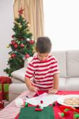 Cute boy drawing festive pictures  — Stock Photo