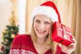 Festive blonde holding a gift — Stok fotoğraf