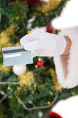 Hand of santa holding credit card — Photo
