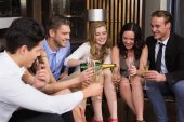 Stylish friends having a drink together — Stock Photo