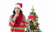 Festive brunette keeping secret and holding gift — Stock Photo