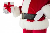 Mid section of santa holding gift — Stock Photo
