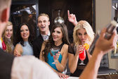 Attractive friends being served cocktails — Stock Photo