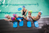 Swimming class and coach smiling — Foto Stock