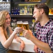 Young couple having a drink together — Stock Photo #57260147