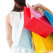 Rear view of brown hair holding shopping bags — Stock Photo #57260897