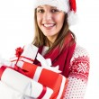 Festive brunette with santa hat holding many gifts — Stock Photo #57261595