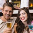 Happy couple having a drink together — Stock Photo #57261783