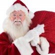 Jolly Santa carries his sack — Stock Photo #57262209