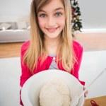 Festive little girl making christmas cookies — Stock Photo #57262293