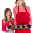 Festive mother and daughter making christmas cookies — Stock Photo #57262813