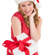Cute woman in red dress offering gift — Stock Photo #57263213