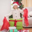 Cute little girl sitting in giant christmas gift — Stock Photo #57263625