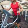 Determined man working out on x-trainer — Stock Photo #57263773