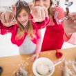 Festive mother and daughter making christmas cookies — Stock Photo #57263929