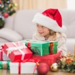 Cute little girl surrounded by christmas gifts — Stock Photo #57264229