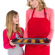 Festive mother and daughter making christmas cookies — Stock Photo #57264777