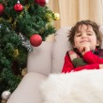 Festive little boy smiling at camera — Stock Photo #57265325