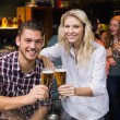 Young couple having a drink together — Stock Photo #57266173