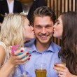 Happy friends having a drink together — Stock Photo #57266553