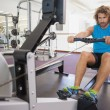 Man using resistance band in gym — Stock Photo #57266767